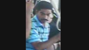The suspect in a sexual assault that took place aboard a 17 Birchmount TTC bus is pictured in this security camera image released by Toronto police on August 08, 2013. (Police handout)
