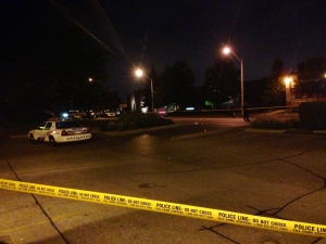 Police tape and a cruiser are seen in this photograph following a shooting in the Overlea Boulevard and Don Mills Road area on Monday, Aug. 12, 2013. (CP24/Cristina Tenaglia)