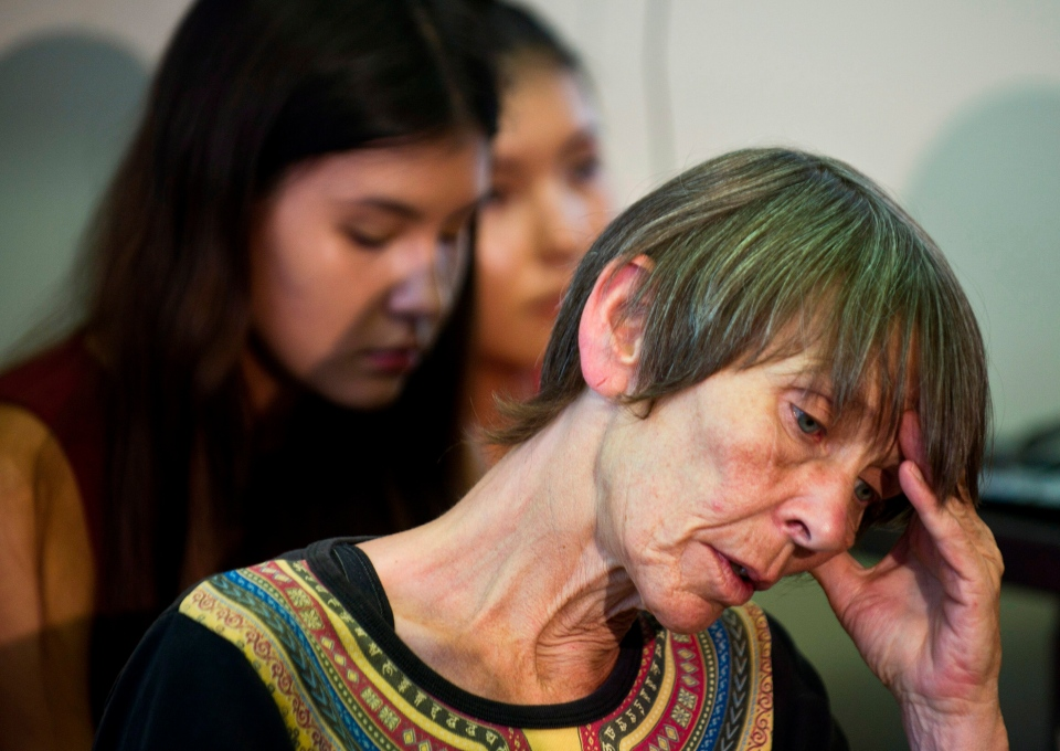 Ruth Schaeffer, whose son Levi Schaeffer was shot and killed by police in 2009, hangs her head at a press conference held by families of police shooting victims Tuesday, Aug. 13, 2013, in the wake of Sammy Yatim's death. (The Canadian Press/Galit Rodan)