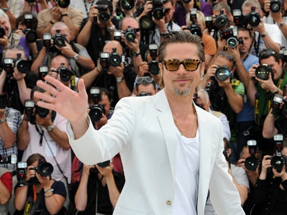Actor Brad Pitt waves during a photo call for The Tree of Life at the 64th international film festival, in Cannes, southern France, Monday, May 16, 2011. (AP Photo/Jonathan Short)