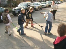 City councillors are voting on an amendment to Toronto's street hockey ban May 16, 2011.