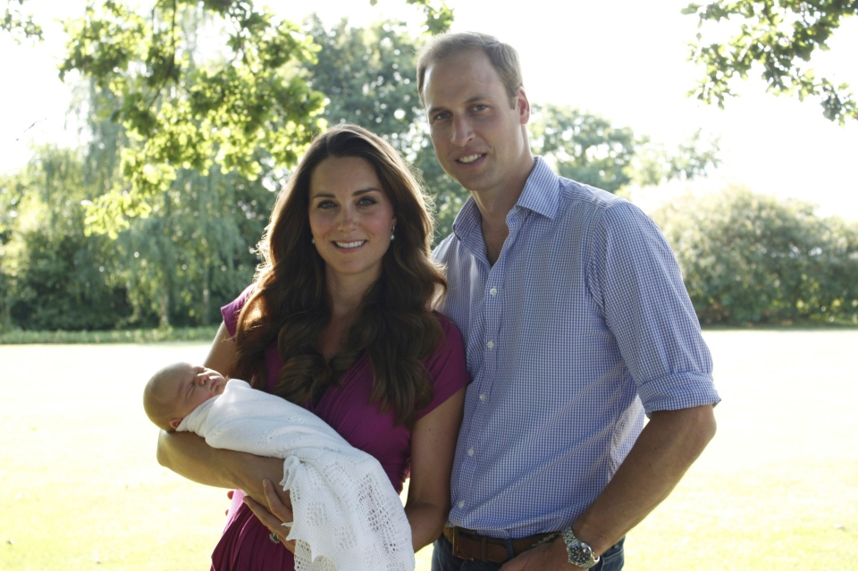 This image taken by Michael Middleton, the Duchess of Cambridge's father, in early August 2013 shows the Duke and Duchess of Cambridge with their son, Prince George, in the garden of the Middleton family home in Bucklebury, England. (AP Photo/Michael Middleton/TRH The Duke and Duchess of Cambridge)