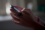 A woman poses for a photo using her smartphone in Rio de Janeiro, Brazil, Wednesday, Aug. 21, 2013. (AP / Silvia Izquierdo)