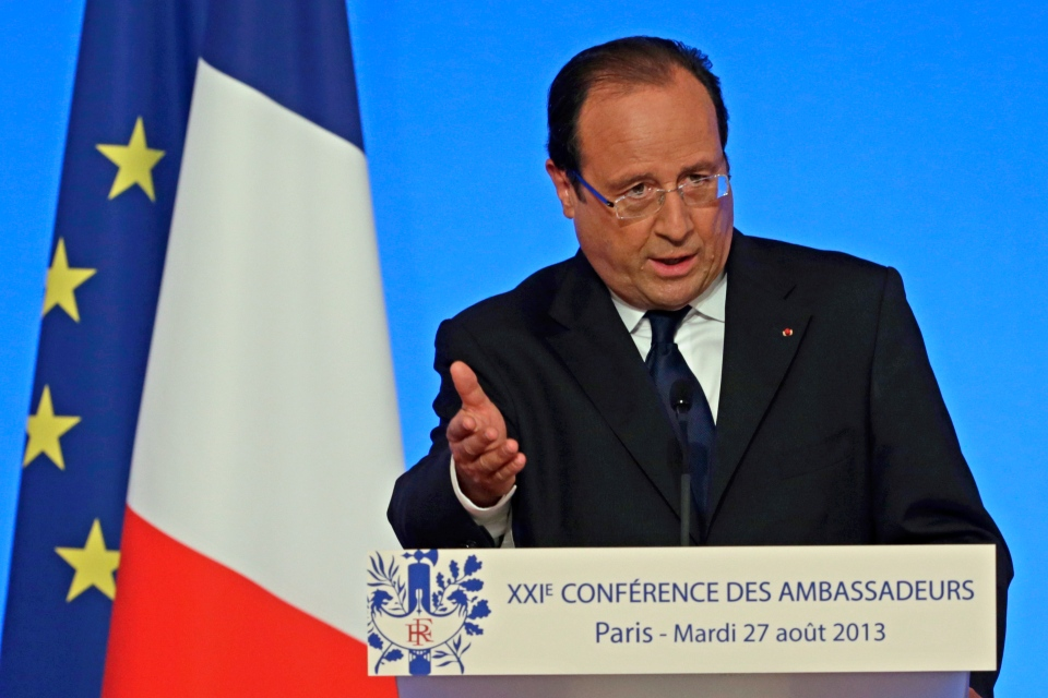 French President Francois Hollande delivers his speech during a conference with France's ambassadors, at the Elysee Palace, in Paris, Tuesday Aug. 27, 2013. Francois Hollande said France is prepared to take action against those responsible for gassing people in Syria. (AP /Kenzo Tribouillard)