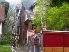 Firefighters battle a blaze at an abandoned home on Oakmount Road on Wednesday, May 25, 2011. (CP24/Cam Woolley)