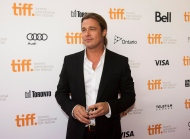 """Actor Brad Pitt poses for photographs on the red carpet at the gala for the new movie """"12 Years a Slave"""" during the 2013 Toronto International Film Festival in Toronto on Friday, Sept. 6, 2013. (The Canadian Press/Nathan Denette)"""