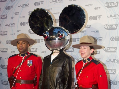 Deadmau5 poses with two Mounties as he arrives at the Juno Awards in Toronto on Sunday March 27, 2011. THE CANADIAN PRESS/Chris Youngcp
