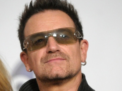 Singer Bono of the rock band U2 poses in the press room at the 2011 Billboard Music Awards in Las Vegas on Sunday, May 22, 2011. (AP Photo/Dan Steinberg)