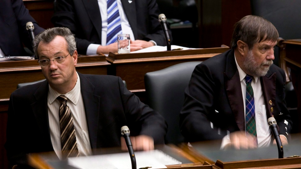 After staging a sit-in at the Ontario Legislature, Conservative MPPs Randy Hillier, left, and Bill Murdoch slam the lids of their desks in protest of the Liberal government's plan to introduce the Harmonized Sales Tax (HST) at Queen's Park in Toronto, Tuesday, December 1, 2009.THE CANADIAN PRESS/Darren Calabrese