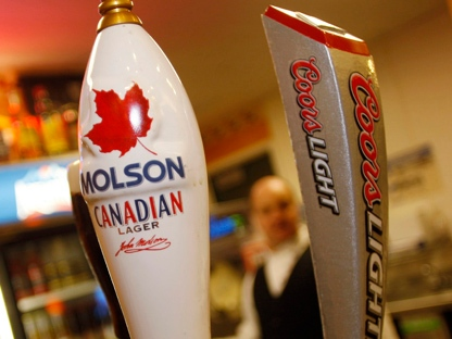 Molson and Coors taps are seen at a vending stand on the concourse of the Pepsi Center before the Colorado Avalanche hosted the Calgary Flames in an NHL game in Denver on Monday, Nov. 5, 2007. (AP Photo/David Zalubowski)
