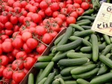 Tomatoes and cucumbers from Holland are displayed for sale at a market in Berlin, Germany, Friday, June 3, 2011. (AP / Michael Sohn)
