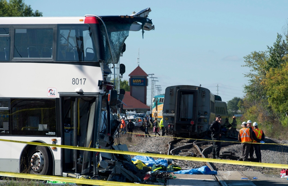 An OC Transpo bus sits where it collided with a Via Rail train during the morning commute in Ottawa on Wednesday, Sept. 18, 2013. (The Canadian Press/Adrian Wyld)