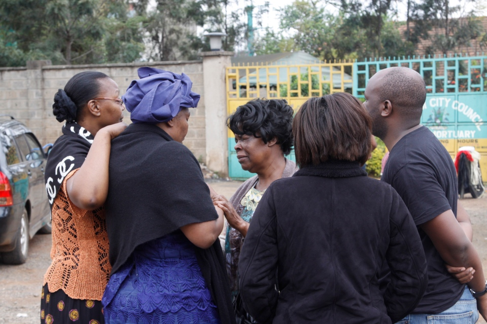 Relatives gather at Nairobi City Mortuary following the mall attack in Kenya on Sunday, Sept. 22, 2013. (AP Photo/Khalil Senosi)