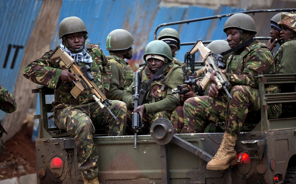 Trucks of soldiers from the Kenya Defense Forces arrive after dawn outside the Westgate Mall on Sunday, Sept. 22, 2013. (AP Photo/Ben Curtis)