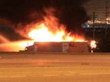 Firefighters battle a blaze at a Bramalea Road truck yard early Monday, June 13, 2011. (CP24/Tom Stefanac)
