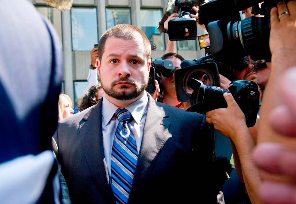 Const. James Forcillo leaves a courthouse in Toronto after being released on bail Tuesday, Aug. 20, 2013. (The Canadian Press/Galit Rodan)