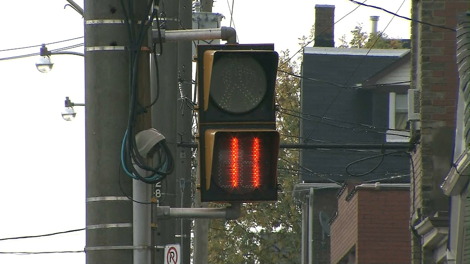 A pedestrian countdown signal is pictured at an intersection in Toronto.