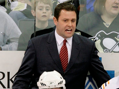 In this April 9, 2009 file photo, New York Islanders coach Scott Gordon works behind the bench during the first period against the Pittsburgh Penguins in a NHL game in Pittsburgh. (AP Photo/Gene J. Puskar, File)