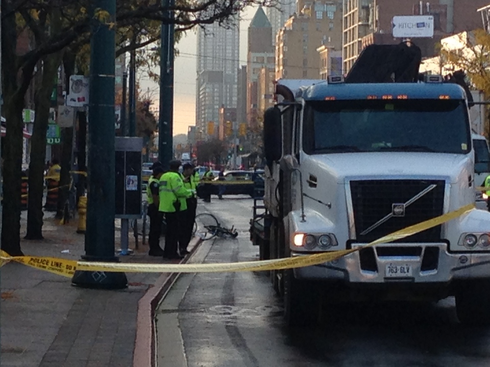 A female cyclist was seriously injured when she was struck by a truck on Spadina Avenue on Wednesday, Oct. 16, 2013. (Mathew Reid/CP24)