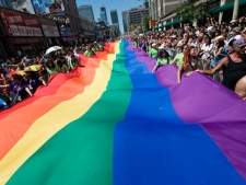 People take part in the Pride Parade in Toronto on Sunday, July 4, 2010. (THE CANADIAN PRESS/Adrien Veczan)