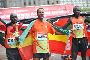 Ethiopia's Sahle Warga, centre, finishes first at the Scotiabank Toronto Waterfront Marathon on Sunday, Oct.14, 2012, followed by Kenyan runners Kiplimo Kimutai and John Kiprotich. (The Canadian Press/HO)