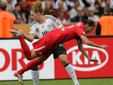 Germany's Kim Kulig, left, and Canada's Christine Sinclair challenge during the group A match between Germany and Canada at the Women�s Soccer World Cup in Berlin, Germany, Sunday, June 26, 2011. (AP Photo/Michael Sohn)