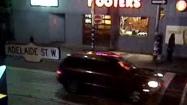 An SUV believed to have been involved in the Oct. 18, 2009 murder of Christopher Skinner is pictured on Adelaide Street in this security camera image released by police on Friday, Oct. 18, 2013. (Handout/Toronto Police)