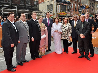Family of famed Bollywood star Raj Kapoor (left to right) sons Rishi Kapoor, Rajiv Kapoor, Randhir Kapoor, Ritu Nanda (daughter), Premier Dalton McGuinty, his widow Krishna Raj Kapoor, Reema Jain (daughter), Manoj Jain (son-in-law), actor and host Anupam Kher, and TIFF's Noah Cowan stand for a photo on the red carpet during the Raj Kapoor Family Tribute event on Sunday, June 26, 2011 during the IIFA Film Festival at the TIFF Bell Light Box in Toronto. (THE CANADIAN PRESS/Aaron Vincent Elkaim)