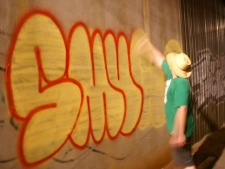 'Smug', a graffiti writer, leaves his mark in an alleyway in Toronto's Little Portugal neighbourhood. (Paul Johnston, CP24.com)