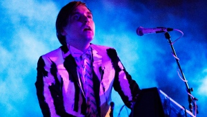 William Butler, a member of Arcade Fire, plays on Thursday, Oct. 24, 2013 at the Little Haiti Cultural Center in Miami. (AP Photo/Eric Kayne)