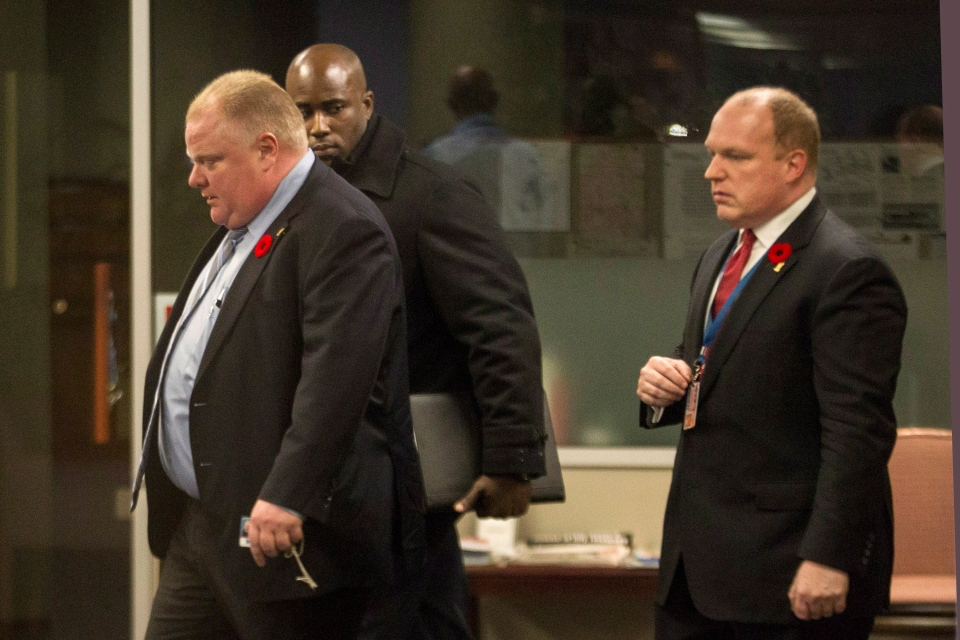 Toronto City Mayor Rob Ford (left) leaves Toronto's city hall with his driver and Chief of Staff Earl Provost on Thursday November 7, 2013. (Chris Young/The Canadian Press)