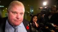 Toronto Mayor Rob Ford makes a statement to the media outside his office at Toronto's city hall after the release of a video on Thursday November 7, 2013. (Chris Young/The Canadian Press)