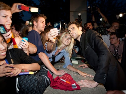 "Actor Matthew Lewis, right, who plays the character Neville Longbottom in the Harry Potter films, poses with fans following the Canadian premiere of ""Harry Potter and the Deathly Hallows: Part 2"" in Toronto Tuesday, July 12, 2011. (THE CANADIAN PRESS/Darren Calabrese)"