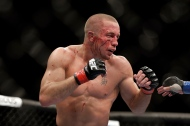 Georges St. Pierre, of Canada, fights Johny Hendricks during a UFC 167 mixed martial arts championship welterweight bout on Saturday, Nov. 16, 2013, in Las Vegas. St. Pierre won by split decision. (AP Photo/Isaac Brekken)