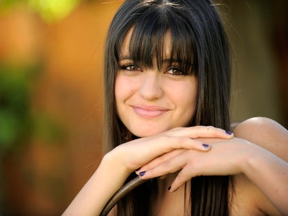 In this April 15, 2011 photo, teen pop singer Rebecca Black poses for a portrait in Los Angeles. Black debuted her second music video,