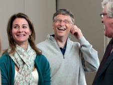 Melinda Gates, left, and husband Bill Gates laugh with Jeff Raikes following speaking at the opening reception of the Bill & Melinda Gates Foundation Thursday, June 2, 2011, in Seattle. The foundation formally opened the new headquarters Thursday evening, moving from scattered nondescript office buildings around Seattle to an architectural showcase in the center of its hometown. (AP Photo/Elaine Thompson)