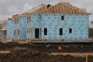 A construction worker works on a house in a new housing development in Oakville, Ont., in this file photo. (The Canadian Press/Richard Buchan)