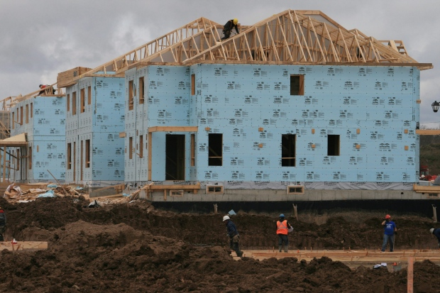 Freedom 58 half of canadians doing more to pay down their for Mortgage for house under construction