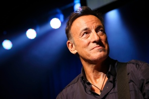 This Nov. 7, 2013 file photo shows musician Bruce Springsteen stands on stage at the Stand Up for Heroes event at Madison Square Garden in New York. (John Minchillo/Invision/AP)