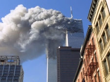 In this Sept. 11, 2001 file photo, the twin towers of the World Trade Center burn after hijacked planes crashed into them in New York. (AP Photo/Diane Bondareff, File)