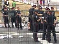 Police officers are shown at the scene of a shooting along the route of Toronto's Caribbean festival parade, Saturday, July 30, 2011. (CTV)