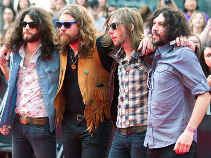 Canadian band The Sheepdogs pose for photographs on the red carpet during the 2011 MuchMusic Video Awards in Toronto on Sunday, June 19, 2011. THE CANADIAN PRESS/Darren Calabrese