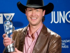 Paul Brandt holds his Juno award for Country Recording of the Year during the Juno Awards in Calgary Sunday, April 6, 2008. (THE CANADIAN PRESS/Larry Macdougal)