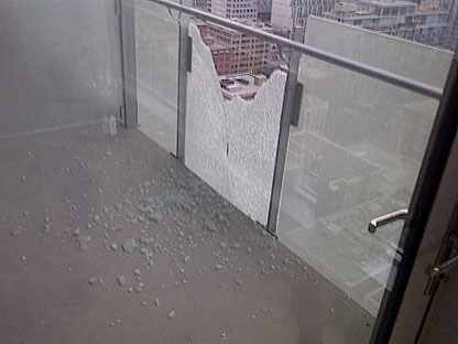 The aftermath after a piece of glass fell from the 27th floor of Festival Tower of John Street at around 7:40 p.m. Tuesday.
