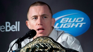 Welterweight UFC Champion Georges St-Pierre responds to a question during a news conference Wednesday, Jan. 23, 2013 in Montreal. (The Canadian Press/Paul Chiasson)