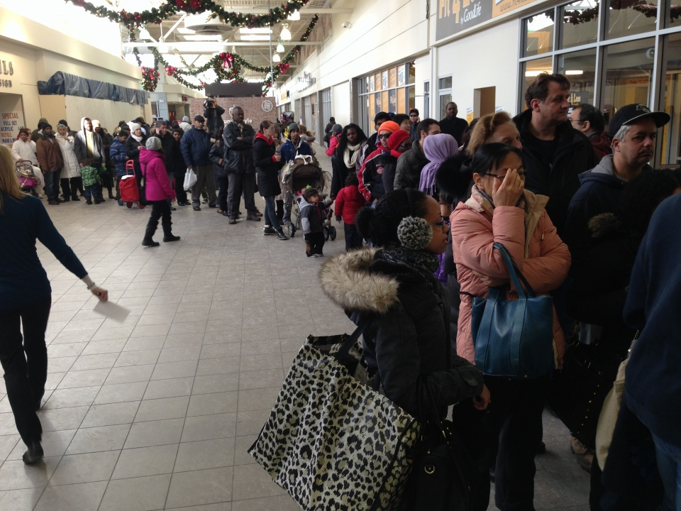 People line up at the Golden Mile employment and social services office as they await the arrival of additional gift cards on Tuesday, Dec. 31, 2013. (Jackie Crandles/CP24)