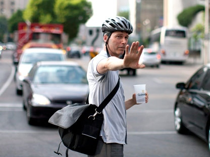 A member of the public directs traffic at a busy intersection during rush hour as traffic lights fail in downtown Toronto as a power outage leaves much of the city core without electricity on Monday July , 2010. THE CANADIAN PRESS/Chris Young