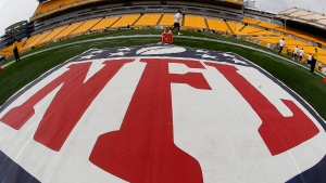 In this image made with a fisheye lens, the NFL logo is displayed on the sideline of Heinz Field in Pittsburgh on Sept. 8, 2013. (AP/Keith Srakocic)