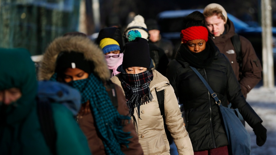 People make their way to work in Toronto during a deep freeze Tuesday, Jan. 7, 2014. (The Canadian Press/Mark Blinch)