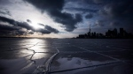 A frozen Lake Ontario is seen in front of the skyline during sub-freezing temperatures in Toronto Tuesday, Jan. 7, 2014. (The Canadian Press/Mark Blinch)